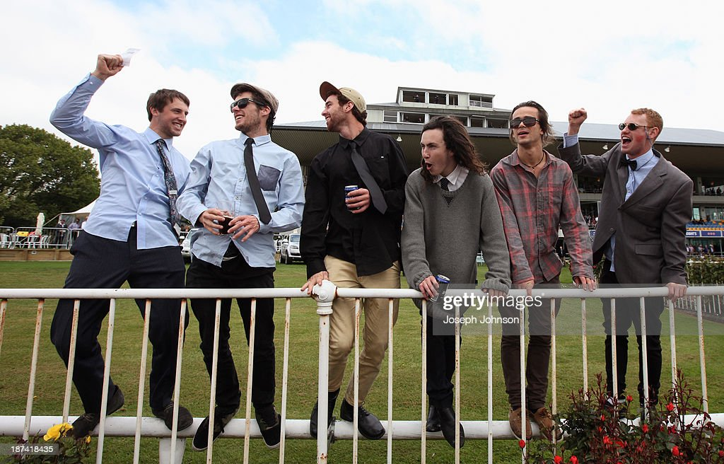 Punters celebrate a well placed bet in the Gartshore Group Premier race during New Zealand 2000 Guineas Day on November 9, 2013 in Christchurch, New Zealand.