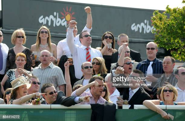 Punters celebrate during the totesportcom Chester Cup Day meeting at Chester Racecourse
