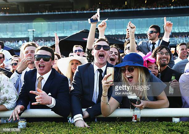 Punters display their jubilation at result of Race 9 at The Star Epsom Day at Royal Randwick Racecourse on October 4 2014 in Sydney Australia