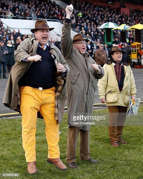 Punters jumps for joy as they watch Irish Cavalier win The Guinness Handicap Steeplechase at Punchestown racecourse on April 27 2016 in Naas Ireland
