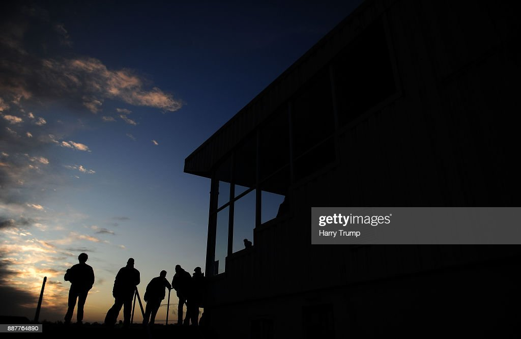 Punters look on as they final race of the day takes place at Wincanton Racecourse on December 7, 2017 in Wincanton, England.
