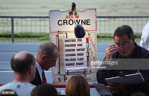 Punters place bets during the farewell gala evening at Walthamstow Greyhound Stadium on August 16 2008 in London England The famous Walthamstow...