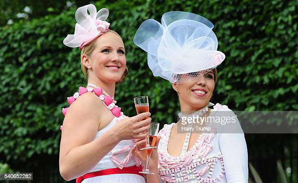 Punters pose for photographs during Day Three of Royal Ascot 2016 at Ascot Racecourse on June 16 2016 in Ascot England
