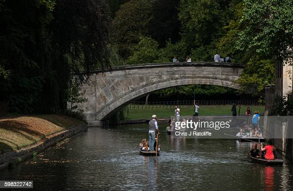 Punters take people down the River Cam on September 1 2016 in Cambridge England Punting is popular with many tourists in Cambridge as they take trips...