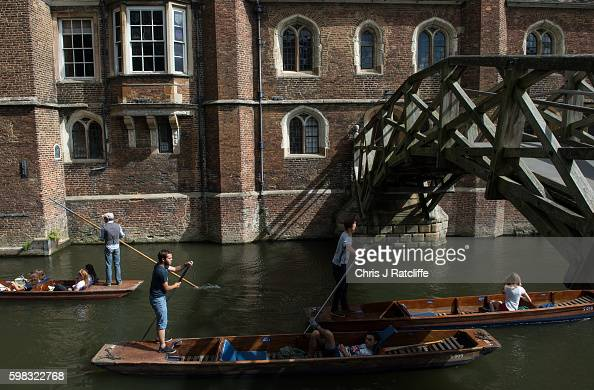Punters take tourists past Queen's College and under Mathmatical Bridge on the River Cam on September 1 2016 in Cambridge England Punting is popular...