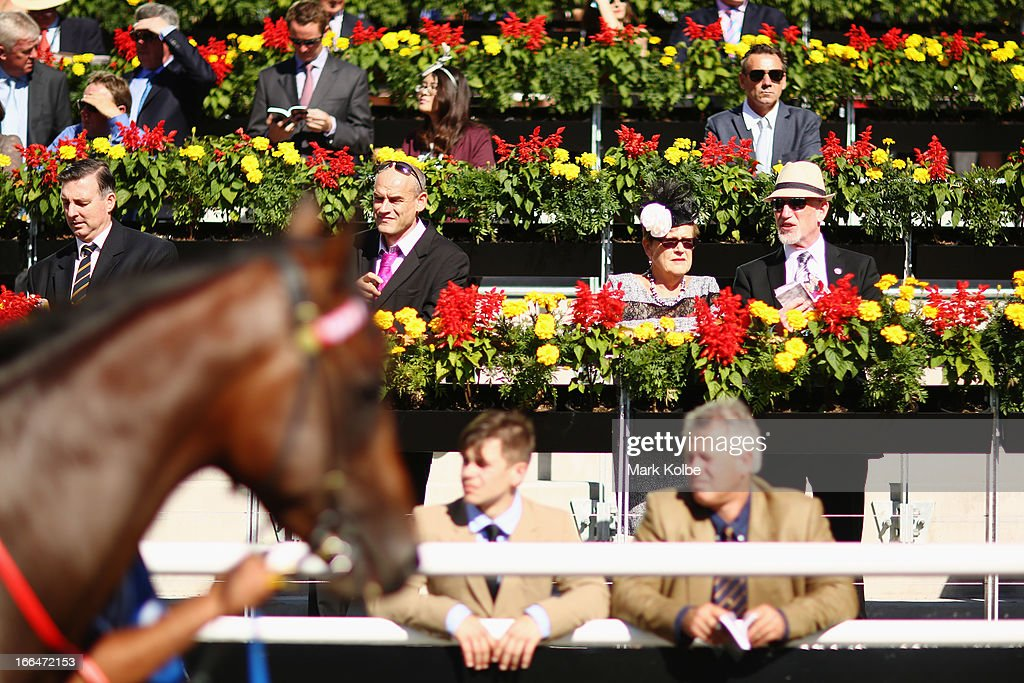 Punters watch on as horse pass in the mounting yard on Australian Derby Day at Royal Randwick Racecourse on April 13, 2013 in Sydney, Australia.