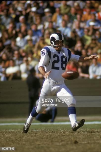Punter/wide receiver Pat Studstill of the Los Angeles Rams punts against the San Francisco 49ers at the Los Angeles Memorial Coliseum on November 21...