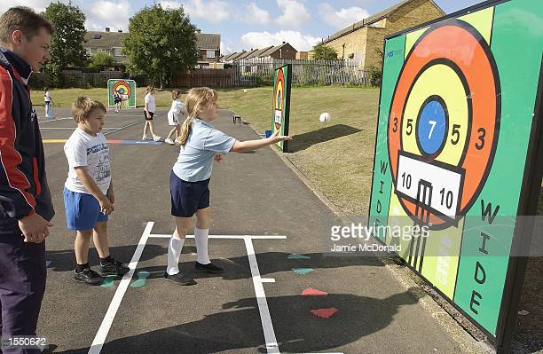 A pupil at Hildene Primary School uses the new playground markings during the England and Wales Cricket Board 'Playground markings to boost school...