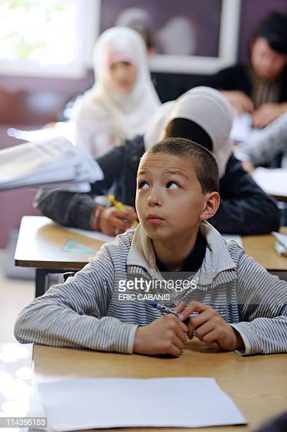 A pupil attends a lesson in a classroom on May 11 2011 at the Alif private muslim school in the French southwestern city of Toulouse Funded by the...