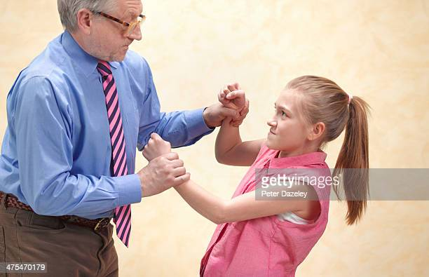 Pupil fighting with teacher
