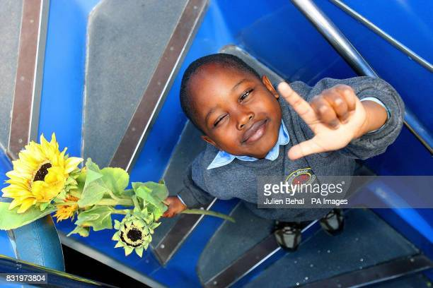 A pupil from Central Model Infant school Marlborough Street holds a sunflower on board the new Dublin Tour Bus powered by biodiesel a pilot scheme...