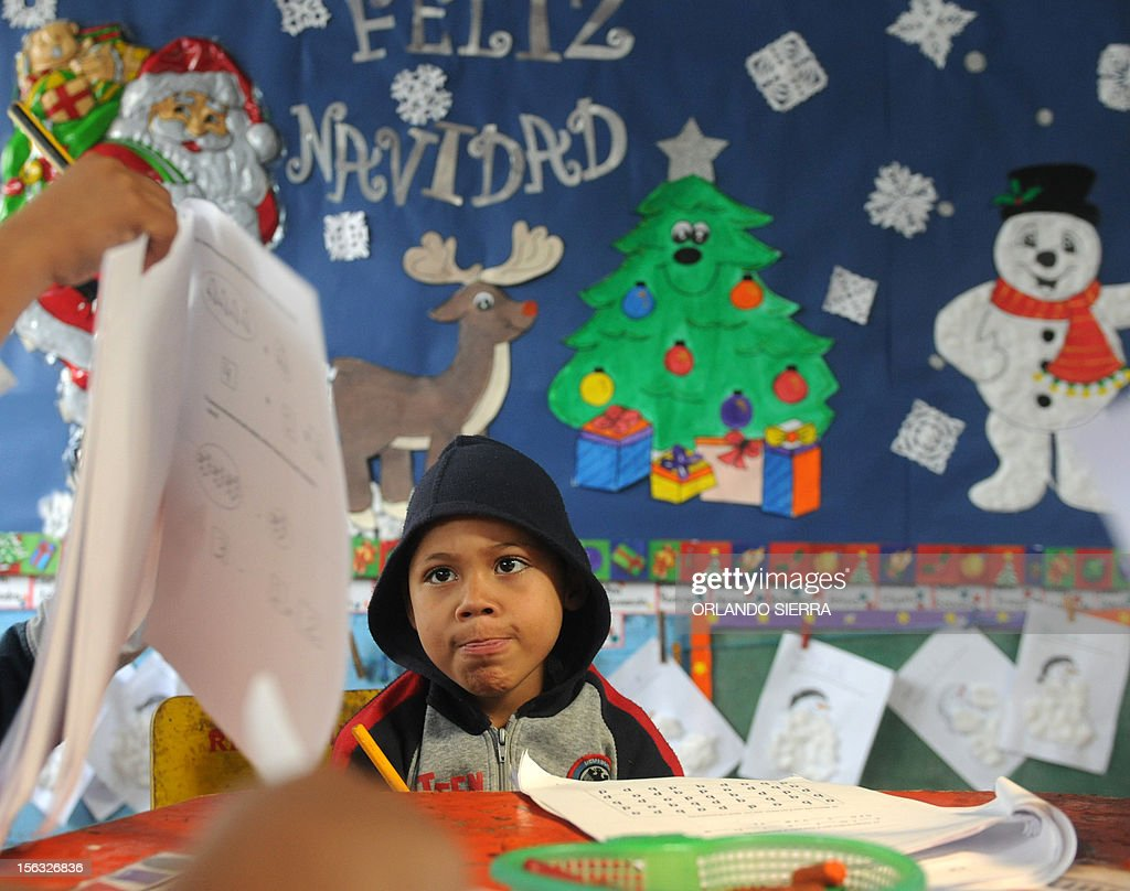 A pupil gestures as he makes an exercise during a class at a nursery school in Tegucigalpa on November 13, 2012. AFP PHOTO/Orlando SIERRA