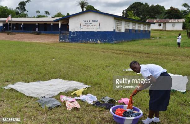A pupil lays out laundry to dry outside the Cecelia Dunbar Public school in the city of Freeman Reserve in the Todee District about 30 miles north of...