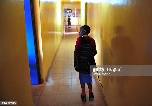 A pupil leaves the classroom of Kibera School for Girls after taking a class to learn how to use computers at Nairobi on May 19 2016 Kibera School...