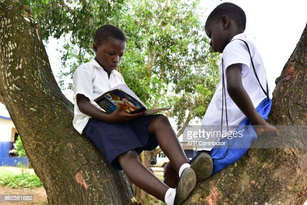 A pupil revises his lessons outside the Cecelia Dunbar Public school in the city of Freeman Reserve in the Todee District about 30 miles north of...