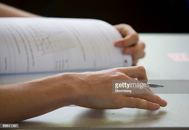 A pupil sitting a GCSE exam studies the question paper at Maidstone Grammar school Maidstone UK on Friday June 12 2009 The UK's 54 billionpound...