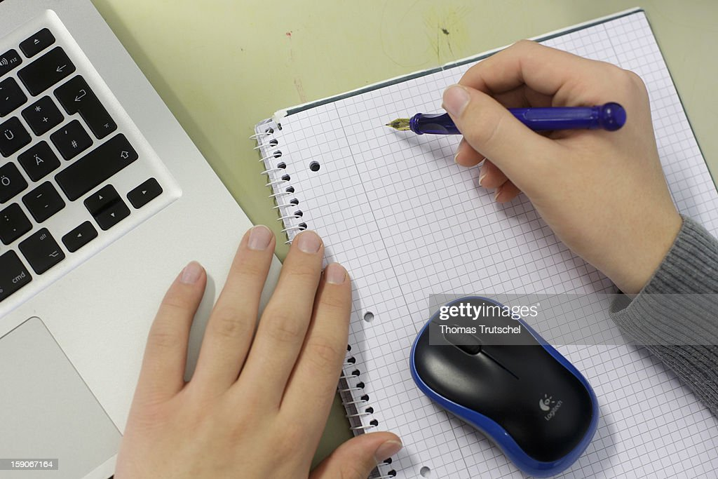A pupil working at a lap-top during a lesson at the Heinrich-Mann-School in the Neukoelln district of Berlin, Germany on November 07, 2012.