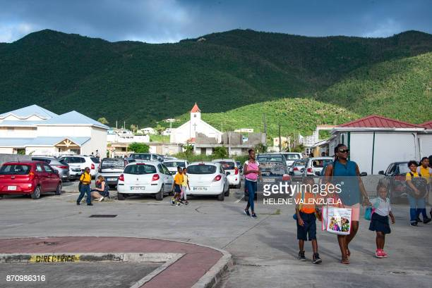 Pupils and parents arrive at The Clair Saint Maximin primary school in Grand Case during a visit of French Prime Minister Edouard Philippe to the...
