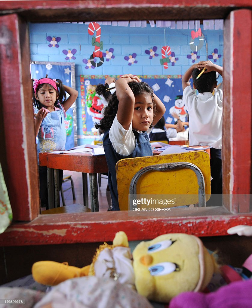 Pupils are pictured at their nursery school in Tegucigalpa on November 13, 2012. AFP PHOTO/Orlando SIERRA