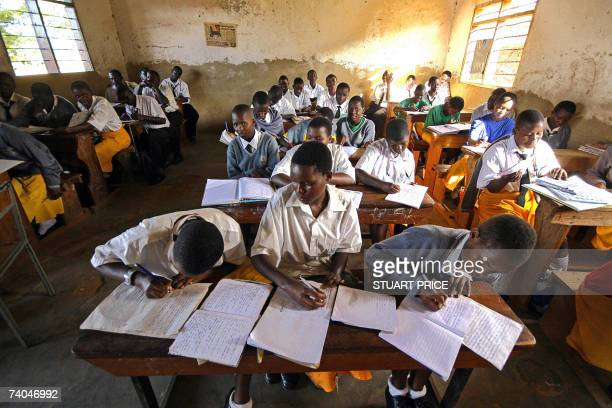 Pupils at Saint Denis Ssebugwawo Secondary School in the Kampala suburb of Ggaba take notes 23 March 2007 The Ugandan government has recently...