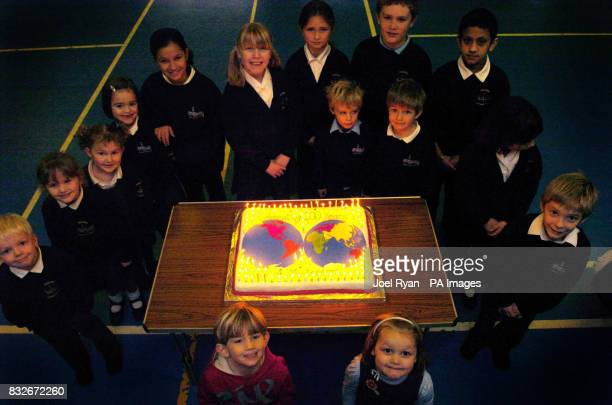 Pupils at Stebbing Primary School Nr Dunmow in Essex celebrate 100 years of the Montessori teaching method on by lighting a special cake