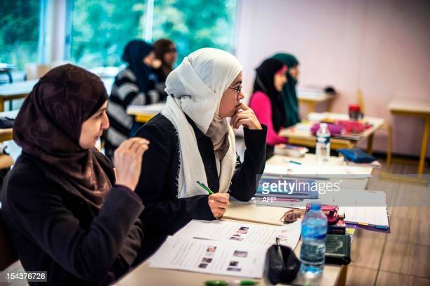 Pupils attend an Arabic course on October 16 in a classroom at the European Institute of Social Sciences in SaintLegerdeFougeret central France The...