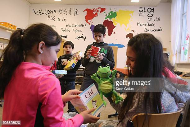 Pupils attend the 'Welcome Class' for immigrant children including children of migrants and refugees at the LeoLionniSchule primary school on January...