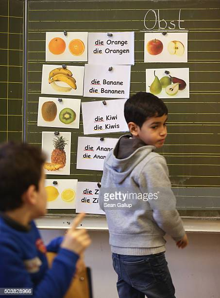 Pupils attending the 'Welcome Class' for immigrant children including children of migrants and refugees learn about the singular and plural forms of...