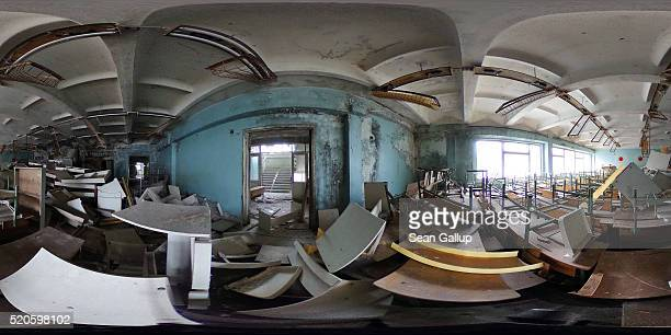 Pupils' desks and chairs stand stacked in a former classroom in elementary school number five on April 9 2016 in Pripyat Ukraine Pripyat built in the...