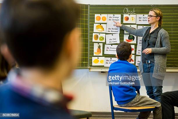 Pupils from different countries attend a lesson in german language at a 'Welcome Class' for immigrant children including children of migrants and...