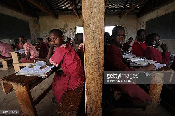 Pupils from different grades share a partitioned classroom at the Oloserian primary school in Kajiado county some 100 kilometres south of the capital...