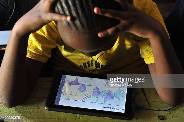 Pupils from Light House Grace academy use the Kio tablet created by the local technology company BRCK Education during a class sesssion in Kawangware...