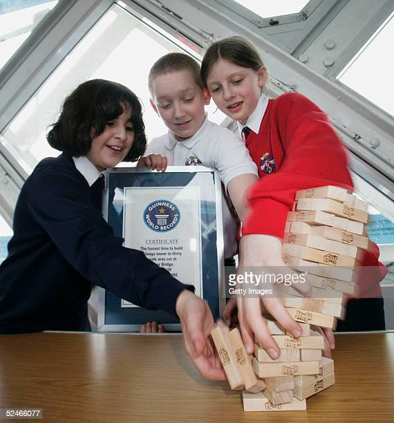Pupils from Sir John Cass's Foundation School Khuncha Sabir Charlie Miller and Ruby Carter following their successful attempt at the Guinness World...