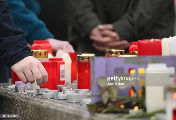 Pupils gather over candles at the JosephKoenigGymnasium high school to pay tribute to 16 students and two teachers from the school who were on...