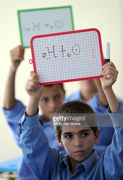 BROUSKY Pupils holds blackboards during an Amazigh class on September 27 2010 in Rabat The Amazigh language was first introduced in elementary...