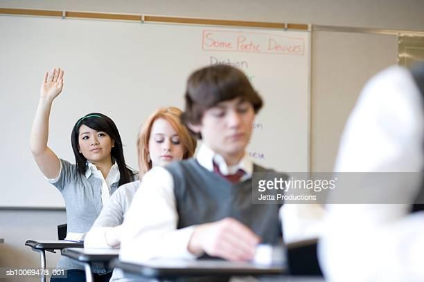 Pupils (15-18) in school classroom, differential focus