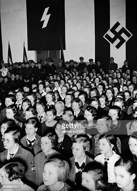 Pupils in the auditorium of the 1 and 29 Volksschule in Berlin Neukoelln during a broadcast adress by Josep Goebbels to the German Youth Photographer...