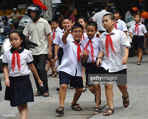 Pupils leave a ceremony to mark the new school year at a local elementary school in downtown Hanoi on September 5 2012 More than one and half million...
