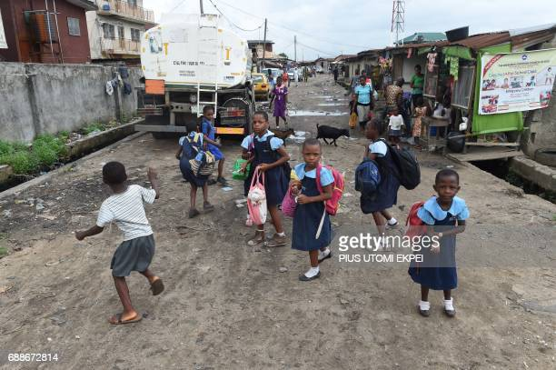 Pupils leave for home after school despite eviction notice served on residents of IlajeBariga waterfront slum mostly inhabited by fishermen and sand...