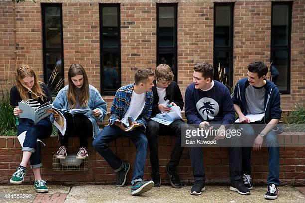 Pupils look at school leaving books after receiving their GCSE results at Stoke Newington School on August 20 2015 in London United Kingdom GCSE...