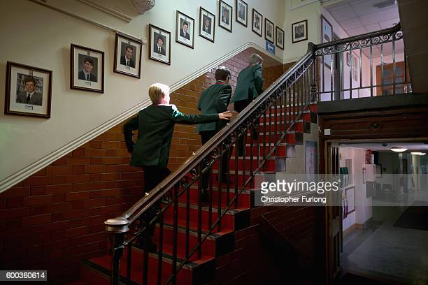 Pupils make their way to class past photographs of former headboys at Altrincham Grammar School for Boys on September 8 2016 in Altrincham England...