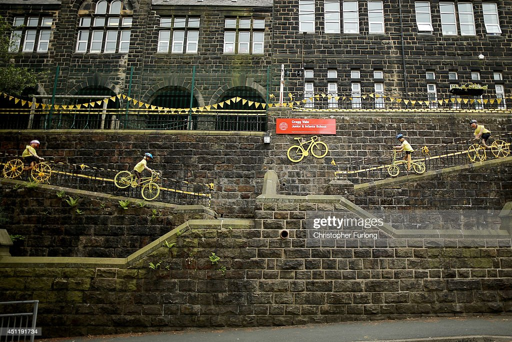 Pupils of Cragg Vale Junior School, Mytholmroyd, have decorated their school on route two as Yorkshire prepares to host the Tour de France Grand Depart, on June 24, 2014 in Mytholmroyd, United Kingdom. The people of Yorkshire are preparing to give the riders of the 2014 Tour de France a grand welcome as the route of stages one and two are decorated with bunting, bikes and yellow jerseys The Grand Depart of the 2014 Tour De France is taking place in Leeds with the first two stages taking place across Yorkshire on 6th and 7th of July.