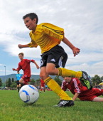 Pupils of HeinrichHeine Gymnasium Kaiserslautern and Staedtisches TheodolindenGymnasium Munich battles for the ball in final game during the DFB...
