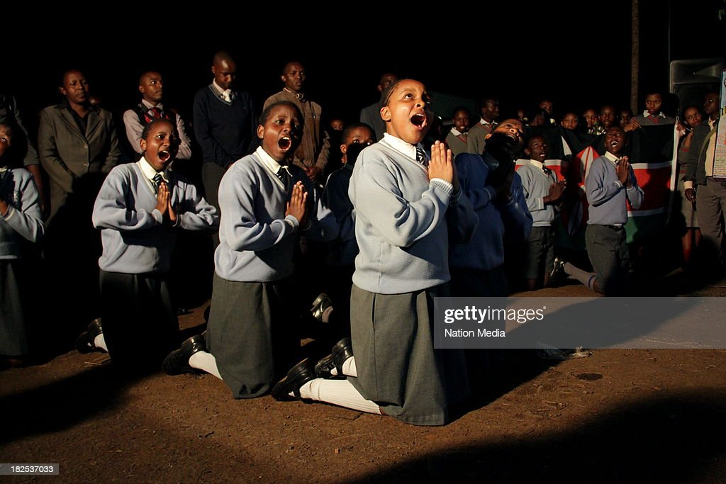 Pupils of Hillstead Academy during prayers and tributes for the Westgate Terror attack victims on September 27 2013 outside Raybells restaurant in...