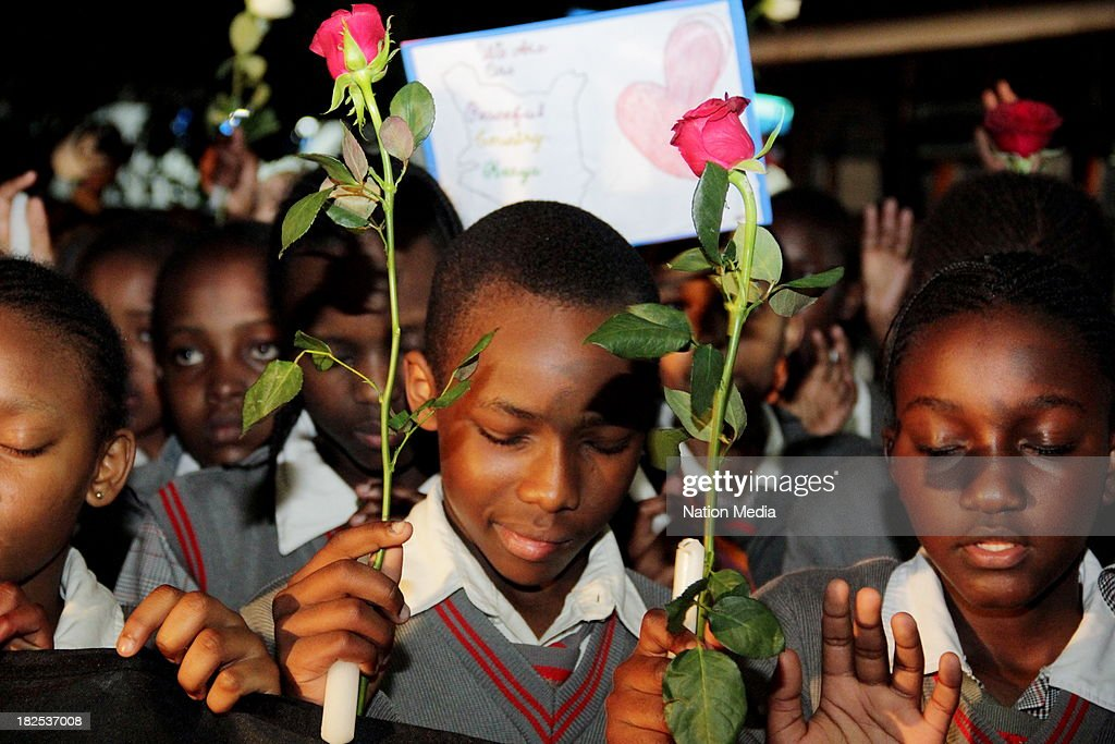 Pupils of Nyeri Good Shepherd during prayers and tributes for the Westgate Terror attack victims on September 27 2013 outside Raybells restaurant in...