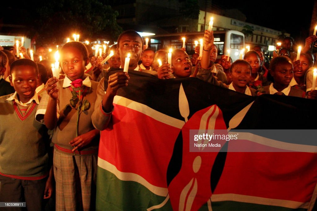 Pupils of Nyeri Good Shepherd School during prayers and tributes for the Westgate Terror attack victims on September 27 2013 outside Raybells...