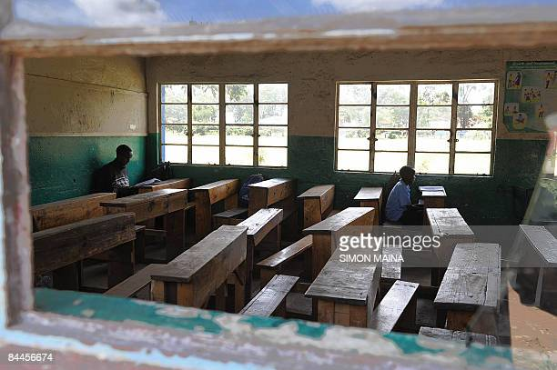 Pupils of the St Paul Primary School in Nairobi sit in an empty classroom on January 26 after the school closed entering its second week in a dispute...