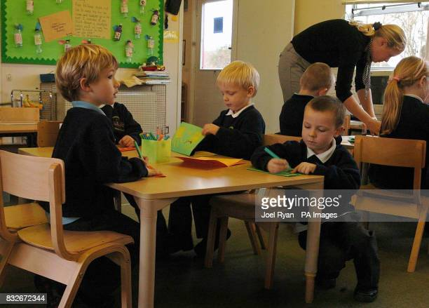 Pupils pictured on with a teacher in class 1 at Stebbing Primary School Nr Dunmow in Essex on the day the school celebrated 100 years of the...
