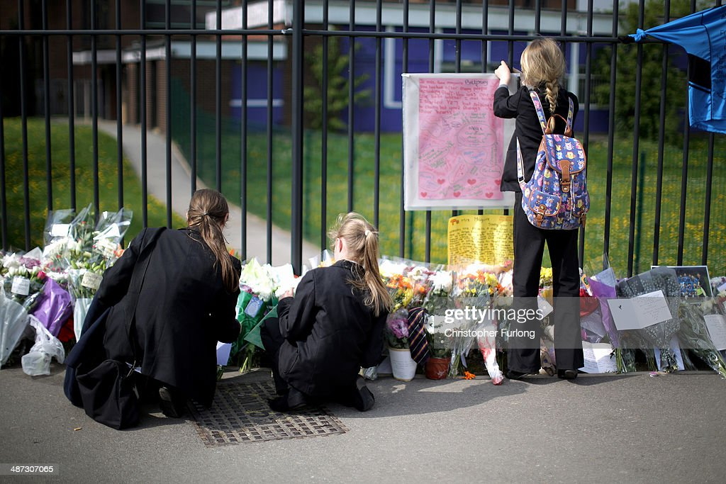 Pupils place tributes to murdered teacher Anne Maguire outside Corpus Christi Catholic College in Neville Road on April 29, 2014 in Leeds, England. A fifteen year old male student has been arrested in connection with the death of teacher Anne Maguire, who was fatally stabbed yesterday during a lesson at Corpus Christi Catholic Catholic College.