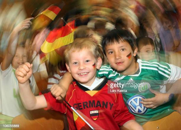 Pupils pose during a visit of the Women National Team of Germany at the HansAndersenSchool on October 26 2010 in Wolfsburg Germany